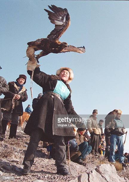 Kazakh hunter lets his golden eagle fly January 27 2001 during a hunting competition in the Elan Tau region of Kazakhstan about 150 km east of the...
