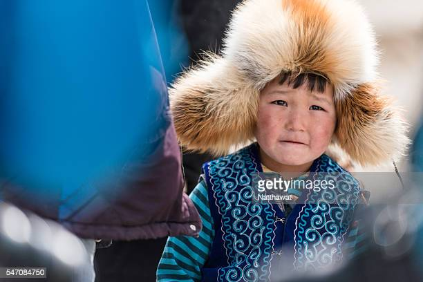 kazakh kid at altai mountain the bayan-ulgii province in western mongolia - kazakhstan stock pictures, royalty-free photos & images