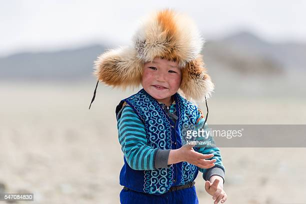 kazakh kid at altai mountain the bayan-ulgii province in western mongolia - independent mongolia stock pictures, royalty-free photos & images
