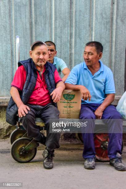 kazakh men sitting on cart - sergio amiti stock pictures, royalty-free photos & images