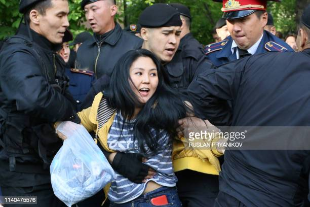 Kazakh police officers detain opposition protesters in Almaty on May 1 2019 Dozens of protesters opposed to Kazakhstan's authoritarian regime were...