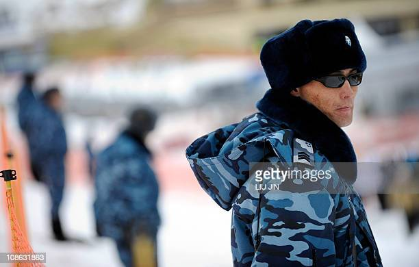 Kazakh policemen stand guard around the arrival area of the Alpine Skiing men's downhill event of the 7th Asian Winter Games at the Shymbulak Alpine...