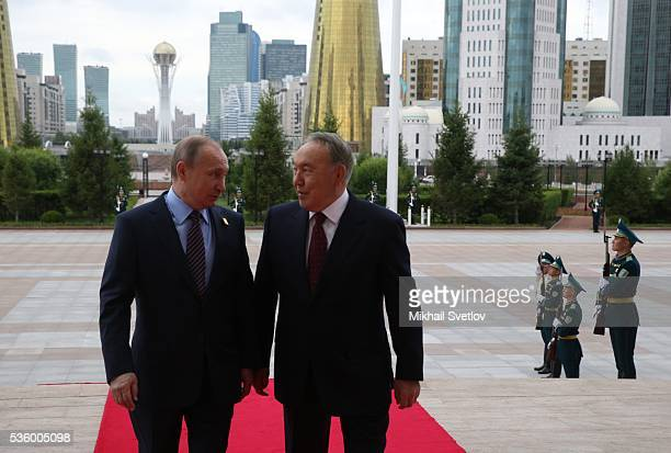 ASTANA KAZAKHSTAN MAY 31 Kazakh President Nursultan Nazarbayev and Russian President Vladimir Putin seen during the Eurasian Economic Union Summit at...
