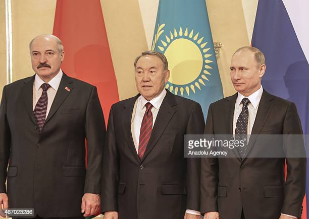 Kazakh president Nursultan Nazarbayev Russian president Vladimir Putin and Belarusian president Alexander Lukashenko pose following the trilateral...
