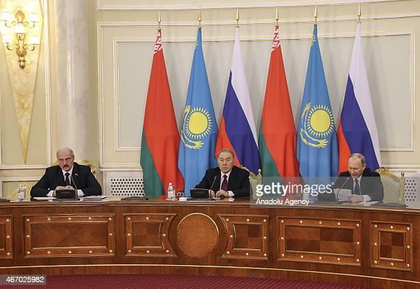 Kazakh president Nursultan Nazarbayev Russian president Vladimir Putin and Belarusian president Alexander Lukashenko are seen after the trilateral...