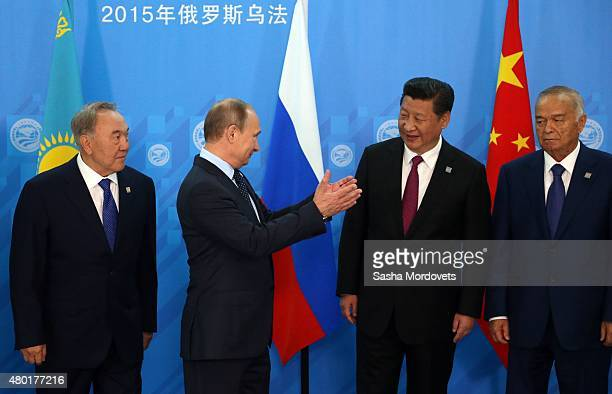 Kazakh President Nursultan Nazarbayev, Russian President Vladimir Putin, Chinese President Xi Jinping and Uzbek President Islam Karimov pose for a...