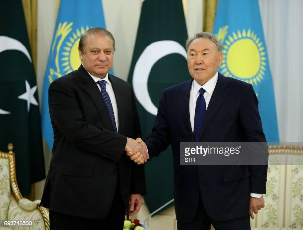 Kazakh President Nursultan Nazarbayev shakes hands with Pakistani Prime Minister Nawaz Sharif during their meeting in Astana on June 8 2017 / AFP...