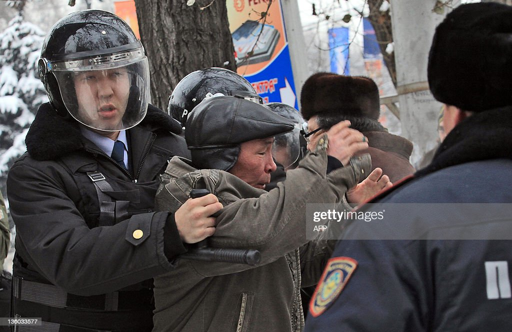 Kazakh riot policeman detain an oppositi : News Photo