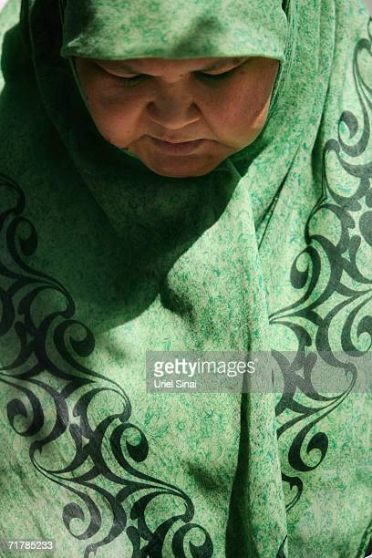 A Kazakh woman recites her Friday Muslim prayers in the Great Mosque on August 11 2006 in Almaty in the central Asian republic of Kazakhstan Fifteen...