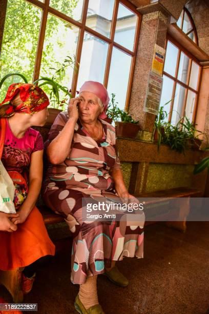 kazakh women sitting on a bench - sergio amiti stock pictures, royalty-free photos & images