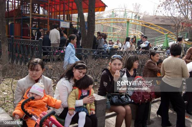 kazakh women with children - kazakhstan stock pictures, royalty-free photos & images