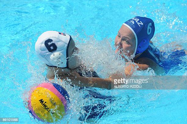 Kazakhstan Anna Zubkova vies with US Tanya Gandi during their 1st round waterpolo game on July 19 2009 at the FINA World Swimming Championships in...