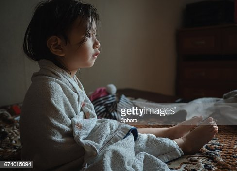 Kazakhstan - Cute 2-3 years girl in bathrobe with wet hair after bath