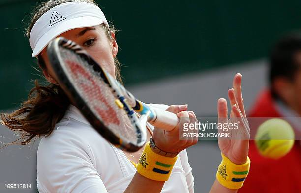 Kazakhstan Galina Voskoboeva hits a forehand shot to USA's Grace Min during a French tennis Open first round match on May 26 2013 at the Roland...