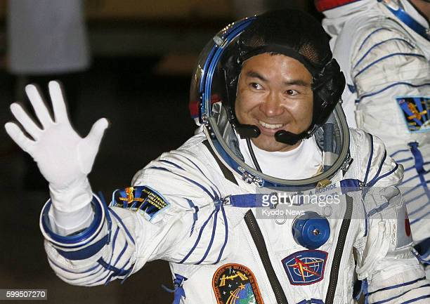 BAIKONUR Kazakhstan Japanese astronaut Akihiko Hoshide waves as he heads to a rocket launch pad at a space center in Baikonur Kazakhstan on July 15...