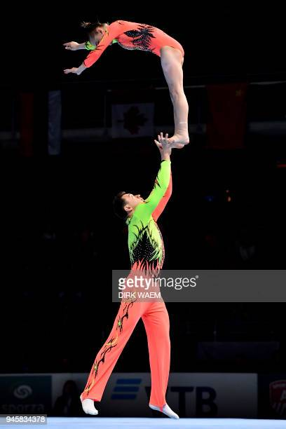 Kazakhstan Mixed Pair Dmitriy Fedkovich and Angelina Yanitskaya perform on the first day of the 26th edition of the World Championships Acrobatic...