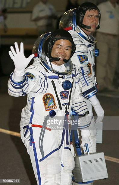 BAIKONUR Kazakhstan Photo shows Japanese astronaut Akihiko Hoshide and Russian cosmonaut Yuri Malenchenko heading to a rocket launch pad at a space...