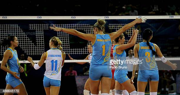 Kazakhstan players celebrate during the FIVB Women's World Championship pool F match between Bulgaria and Kazakhstan on October 4 2014 in Modena Italy
