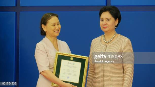 Kazakhstan State Secretary Gulsara Abdikalikova gives award to a journalist during Communication and Information Day award ceremony at the Akorda...
