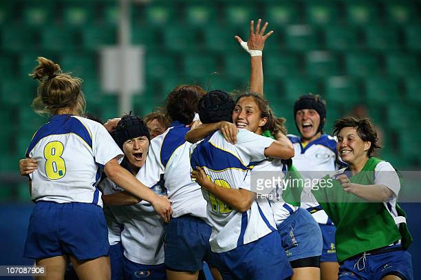 Kazakhstan team celebrate winning the gold in the women's gold medal match of rugby at University Town Main Stadium during day eleven of the 16th...