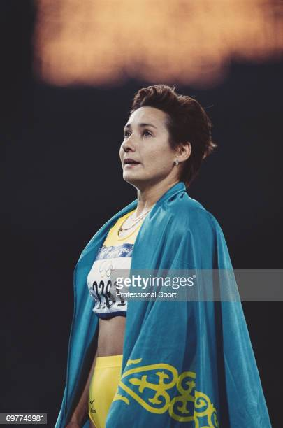 Kazakhstani track athlete Olga Shishigina pictured after crossing the finish line in first place to win the gold medal for Kazakhstan in the final of...