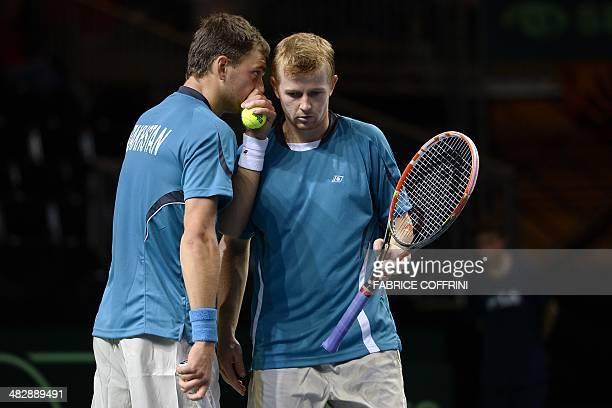 Kazakhstan's Aleksandr Nedovyesov speaks to his teammate Andrey Golubev during their Davis Cup World Group quarterfinal tennis match against...