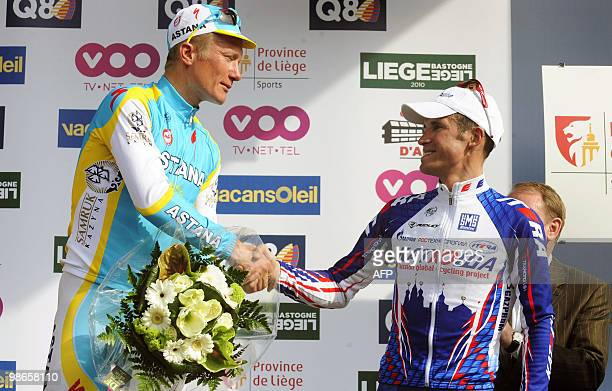Kazakhstan's Alexander Vinokourov of team Astana shakes hands with Russian Alexander Kolobnev of team Katusha on the podium at the end of the 96th...