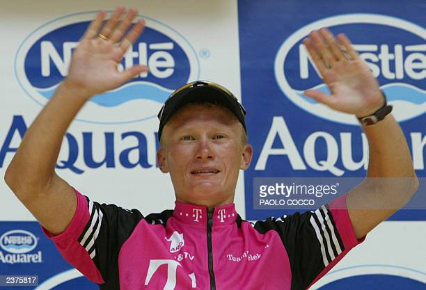 Kazakhstan's Alexandre Vinokourov celebrates on the podium after he won the ninth stage of the 90th Tour de France cycling race between Bourg...