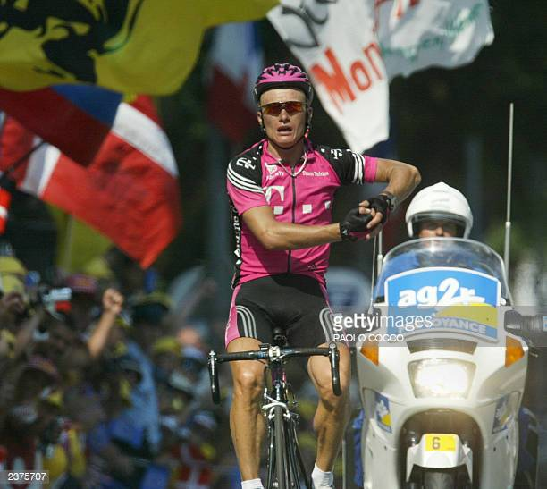 Kazakhstan's Alexandre Vinokourov crosses the finish line and wins the ninth stage of the 90th Tour de France cycling race between Bourg d'Oisans and...