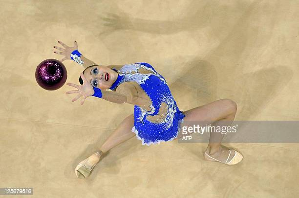 Kazakhstan's Anna Alyabyeva performs with the ball in a qualification round during the 31st Rythmic Gymnastics World Championships on September 20...