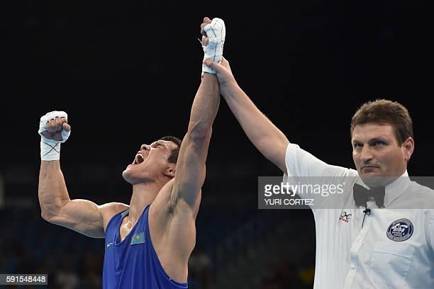 Kazakhstan's Daniyar Yeleussinov celebrates winning against Uzbekistan's Shakhram Giyasov during the Men's Welter Final Bout match at the Rio 2016...