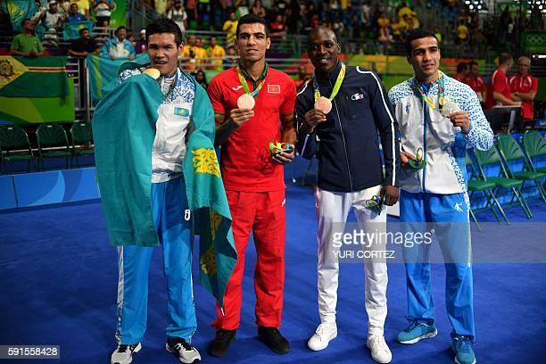 Kazakhstan's Daniyar Yeleussinov Morocco's Mohammed Rabii France's Souleymane Diop Cissokho and Uzbekistan's Shakhram Giyasov pose for a picture with...