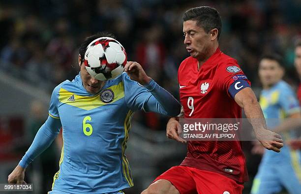 Kazakhstan's defender Yeldos Akhmetov vies for the ball with Poland's forward Robert Lewandowski during the World Cup 2018 football qualification...