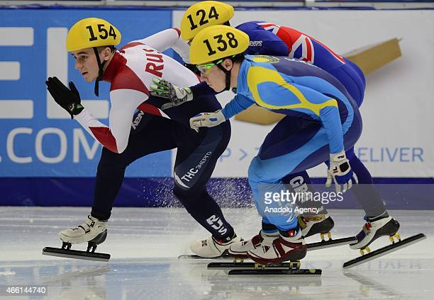 Kazakhstan's Denis Nikisha United Kingdom's Jack Whelbourne and Russian Dmitry Migunov compete during the World Short Track Speed Skating...