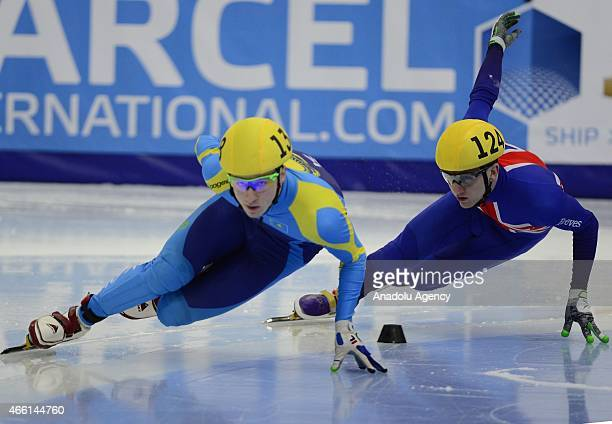 Kazakhstan's Denis Nikisha United Kingdom's Jack Whelbourne compete during the World Short Track Speed Skating Championships at the Krylatskoe...
