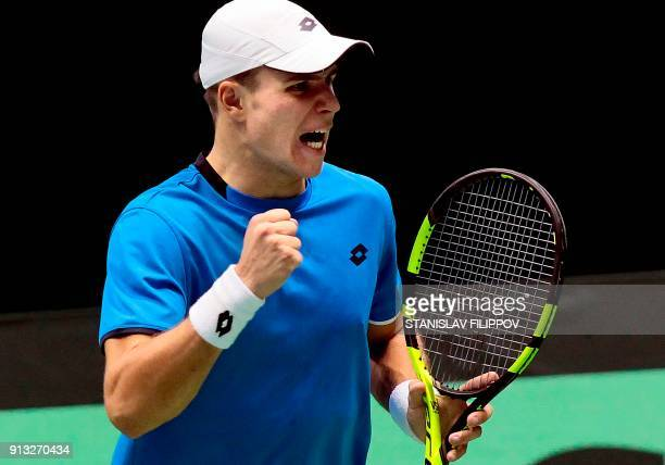 Kazakhstan's Dmitry Popko reacts during his Davis Cup Final match against Switzerland's Henri Laaksonen in Astana Kazakhstan on February 2 2018 / AFP...