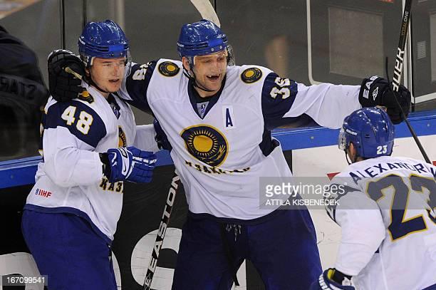 Kazakhstan's Dmitry Upper celebrates his score with his teammates Roman Starchenko and Viktor Alexandrov during the 2013 IIHF Ice Hockey World...