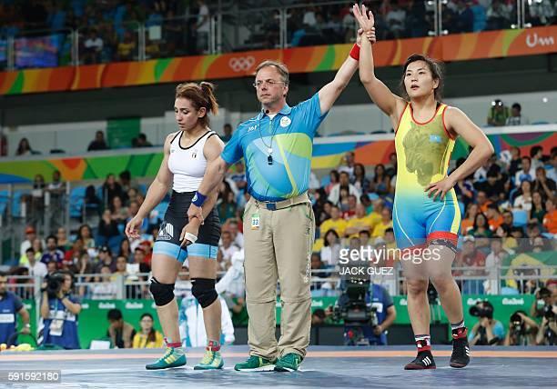 Kazakhstan's Elmira Syzdykova celebrates after winning against Egypt's Enas Mostafa Youssef Ahmed in their women's 69kg freestyle bronze medal match...