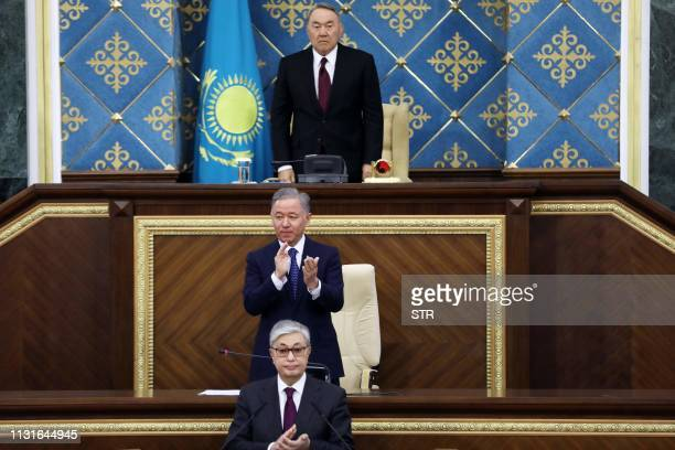 Kazakhstan's interim president KassymJomart Tokayev and former president Nursultan Nazarbayev attend a joint session of the both houses of parliament...