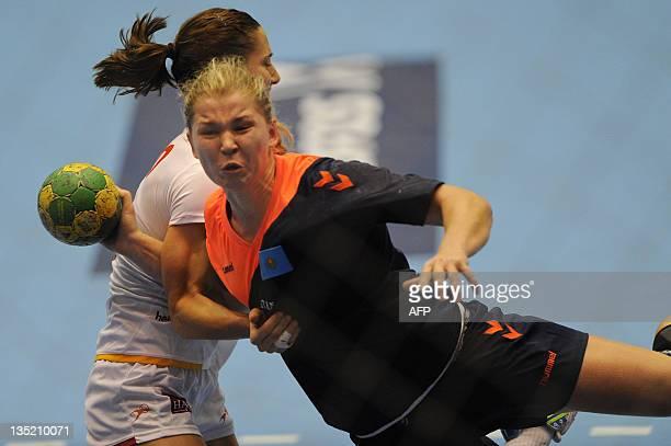 Kazakhstan's Irina Baranovskaya tries to shoot through Spain's defense during their Women's World Handball Championship match in Barueri, Sao Paulo,...