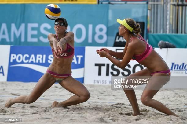 Kazakhstan's Irina Tsimbalova and Tatyana Mashkova compete against Japan in the women's beach volleyball semifinal during the 2018 Asian Games in...