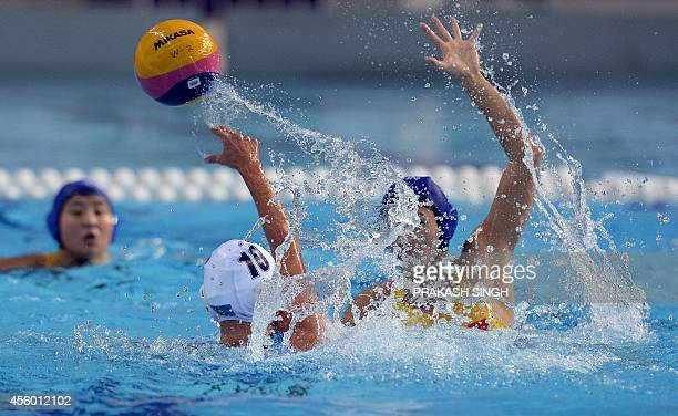 Kazakhstan's Marina Gritsenko pases the ball in their women's waterpolo single round robin match against China at the Dream Park Aquatics centre...