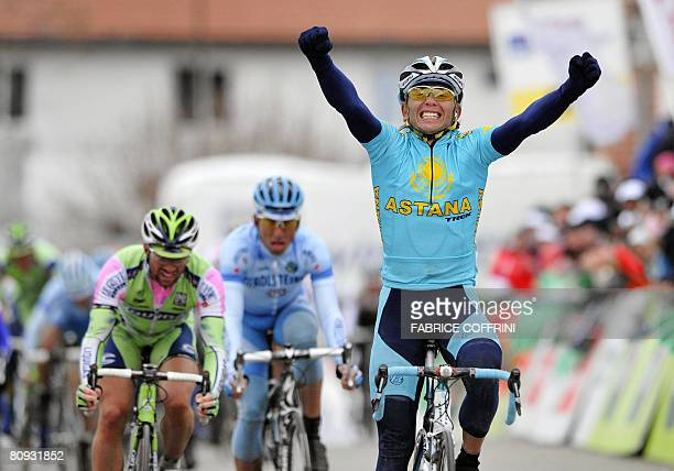 Kazakhstan's Maxim Iglinsky celebrates his victory ahead of Swiss Michael Albasini who came in second and compatriot Markus Zberg who placed third at...