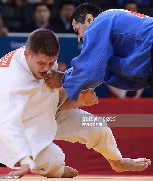 Kazakhstan's Maxim Rakov competes with Azerbaijan's Elmar Gasimov during their men's 100kg judo contest match of the London 2012 Olympic Games on...