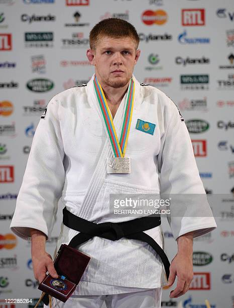 Kazakhstan's Maxim Rakov poses with his silver meda during the podium ceremony for the 100kg category at the Judo World Championships on August 27...
