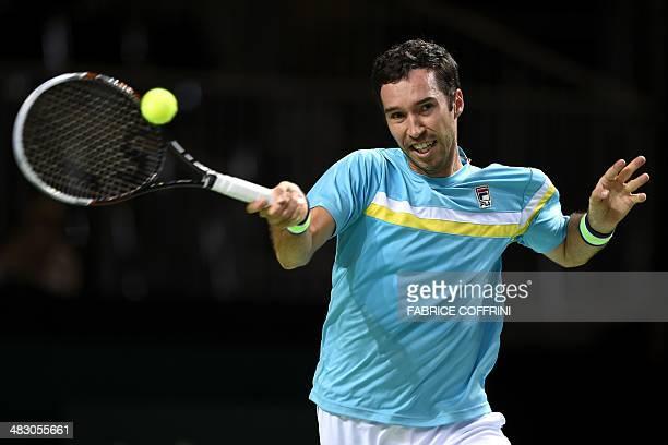 Kazakhstan's Mikhail Kukushkin returns a ball to Switzerland's Stanislas Wawrinka during the tennis Davis Cup World Group quarterfinal between...