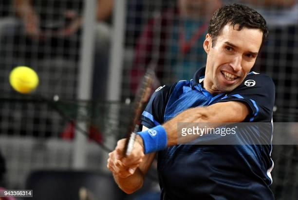 Kazakhstan's Mikhail Kukushkin returns the ball to Croatia's Marin Cilic during the Davis Cup World Group quarterfinal tennis match between Croatia...