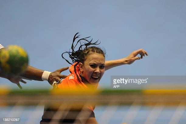Kazakhstan's Natalya Kulakova shoots to score against Spain during their Women's World Handball Championship match in Barueri, Sao Paulo, Brazil on...