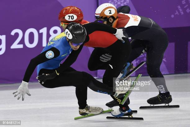 Kazakhstan's Nurbergen Zhumagaziyev, China's Xu Hongzhi and Netherlands' Sjinkie Knegt fall in the men's 1,500m short track speed skating heat event...