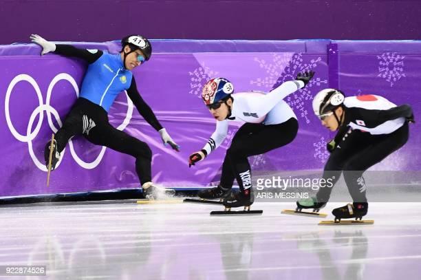 TOPSHOT Kazakhstan's Nurbergen Zhumagaziyev falls next to South Korea's Hwang Daeheon and Japan's Keita Watanabe in the men's 500m short track speed...